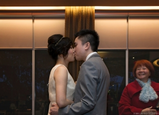 A bride and groom kiss during the wedding ceremony and reception at Kirin Seafood Restaurant (New Westminster location). © 2014 Jenn Lin Photography