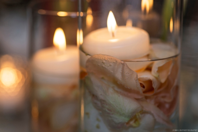 Candles floating on rose petals, an elegant centrepiece. Wedding details. © 2014 Jenn Lin Photography