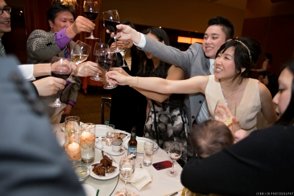 A bride and groom toasting at the reception with guests inside Kirin Seafood Restaurant in New Westminster, BC © 2014 Jenn Lin Photography