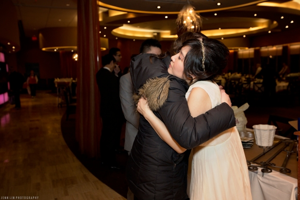 The bride hugs the guests goodbye at her wedding reception at Kirin Seafood Restaurant in New Westminster, BC. © 2014 Jenn Lin Photography