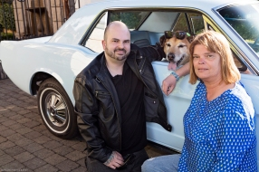 Sunglasses on Dog next to a Vintage Ford Mustang